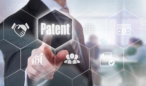 Fotografie, Obraz A businessman selecting a Patent Concept button on a hexagonal screen