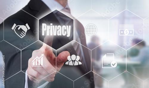 A businessman selecting a Privacy Concept button on a hexagonal screen