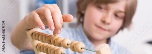 Boy with abacus Canvas Print