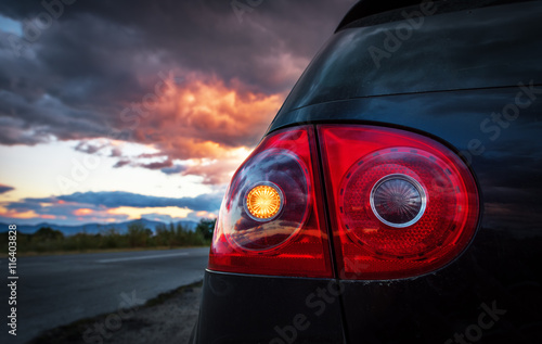Taillight on a modern car. Poster