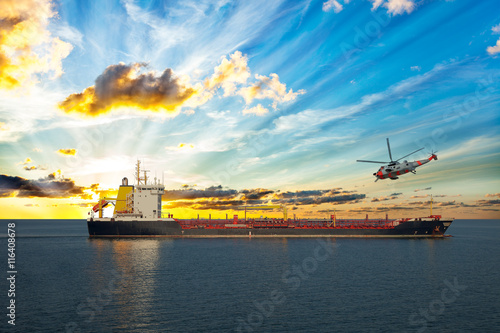 fototapeta na drzwi i meble Coastguard rescue helicopter is approaching the ship.