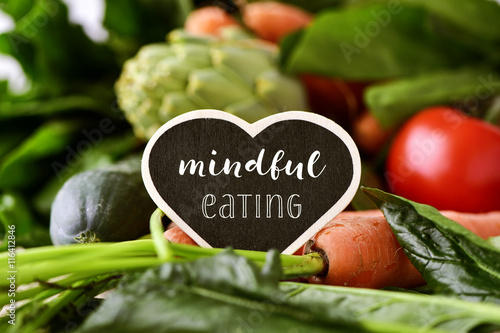 Deurstickers Kruidenierswinkel raw vegetables and text mindful eating