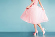canvas print picture - Romantic pink dress with pink shoes on vintage look blue background.