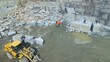 Flying over a stone quarry. Extraction of granite stone. aerial survey