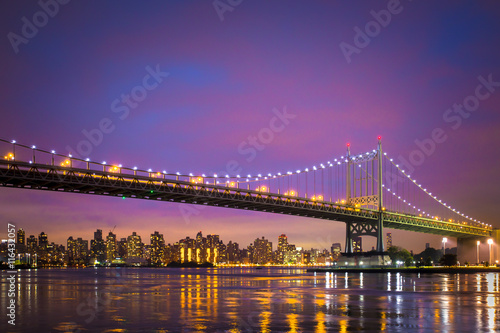 Night view of RFK Triborough Bridge and Manhattan after sunset