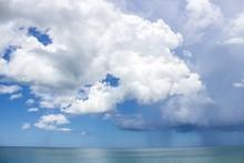 Light And Dark Cumulus Clouds Over Ocean