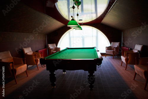 Photo Pool table from natural slate covered with green cloth in Congress Palace, Konstantinovsky Palacebilliard room