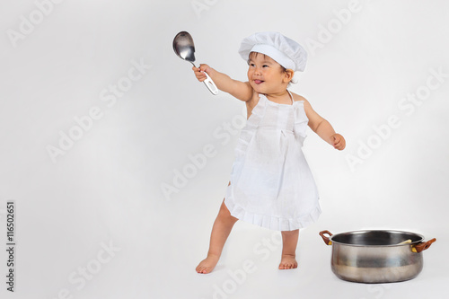 2e87b5ff3ad little baby in a chef s hat and ladle in hand - Buy this stock photo ...