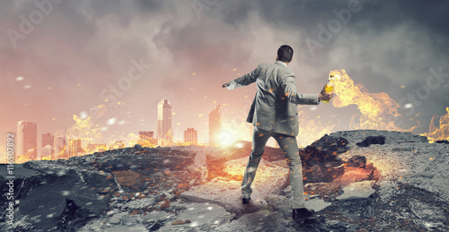 Fotografiet Businessman throwing petrol bomb . Mixed media