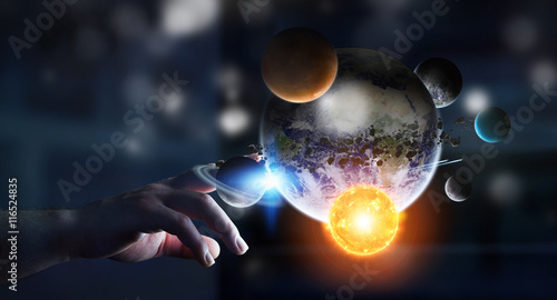 Fototapeta Businessman touching solar system with his fingers obraz