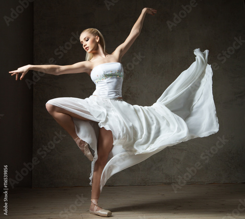 Obraz na plátne Beautiful ballet dancer in white costume with waving skirt dancing