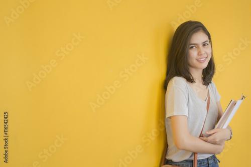 Valokuvatapetti A portrait of an Asian university student on campus