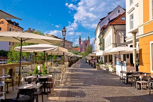 Ljubljana riverfront promenade walkway summer view