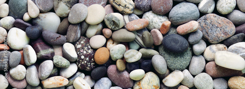 Pebbles background. Panorama / banner Wallpaper Mural