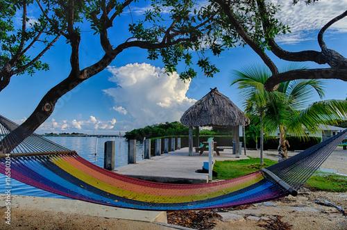 Valokuva  Colorful Hammocks sit bayside at a Florida Keys vacation resort