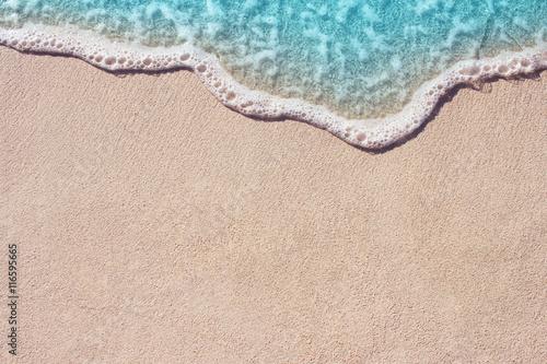 Photo sur Toile Plage Soft ocean wave on the sandy beach