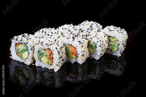 Japanese rolls on black background - 116597055
