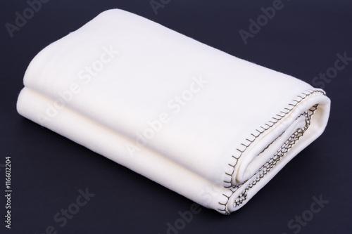 White wool blanket on dark background Poster