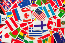 National Flags Of The Different Countries Of The World In A Scattered Heap.