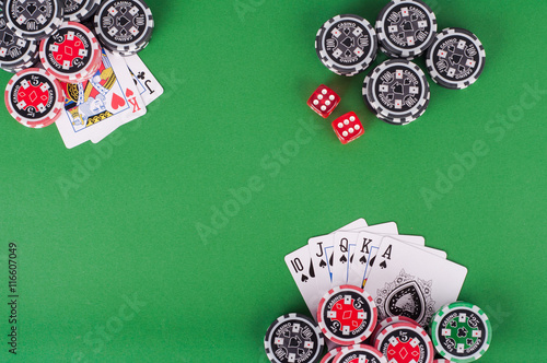 top view of green casino table with royal flush, red and black c Poster