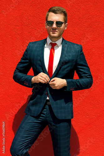 Fotografie, Obraz  model businessman in a blue suit and tie