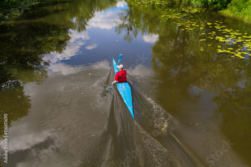 Photo Man on the river training in kayaking. Sport