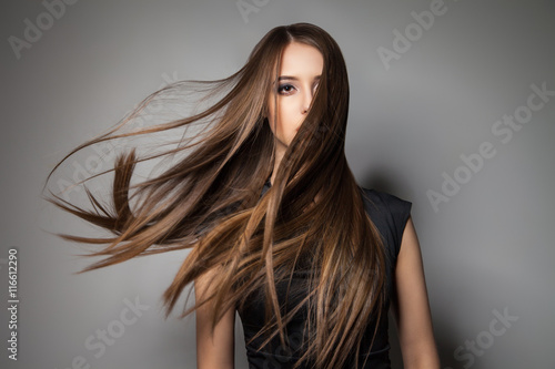 Fotografie, Obraz  Brunette model with windy hair