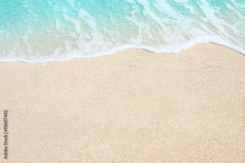 Stickers pour porte Eau Soft wave of sea on the sandy beach, background