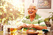 canvas print picture - Elderly Lady has a Meal at Home