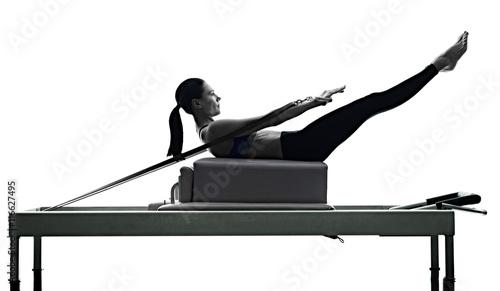 Fototapeta woman pilates reformer exercises fitness isolated obraz
