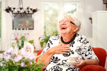 Elderly Lady In Her Living Room