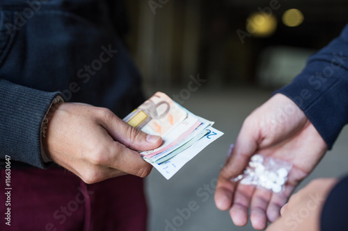 Photo  close up of addict buying dose from drug dealer