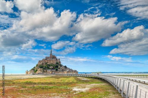 Fotografia Famous historc Mont Saint Michel tidal island with bridge,France