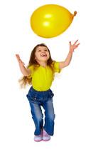 Little Girl Chasing Balloon On...