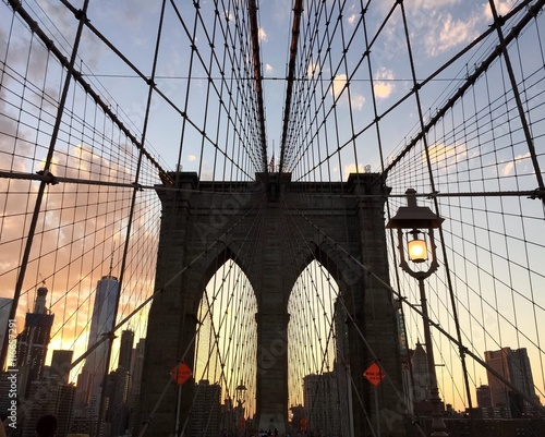 silhouette of Brooklyn bridge and building with sunset sky between Manhattan and Brooklyn