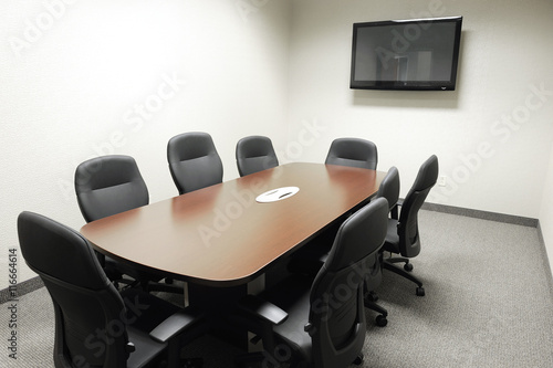 Long Meeting Table And Chairs In The Meeting Room With TV On The - Long meeting table