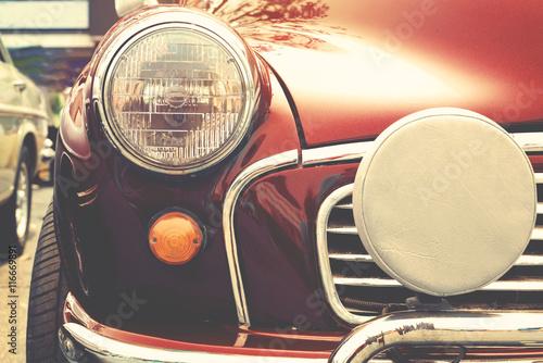 Fotografia, Obraz  Headlight lamp of vintage car - retro color effect style