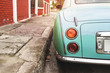 Rear view of classic car parked on street in city - vintage retro color effect styles