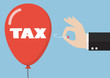 Hand pushing needle to pop the tax balloon
