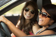 Young woman taking a road trip. Friends driving.