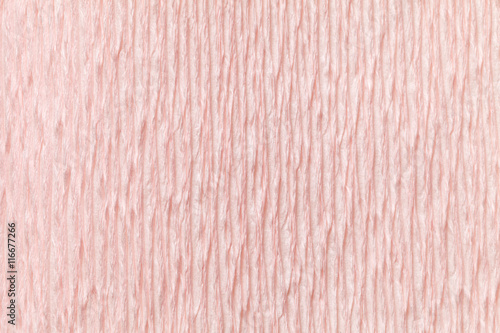 Valokuva  Textural light pink background of wavy corrugated paper, close-up
