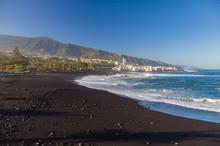 Playa Jardin Beach Against El ...