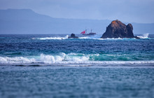 Old Two-masted Schooner Near The Rocks In The Sea. Indonesia, Ba
