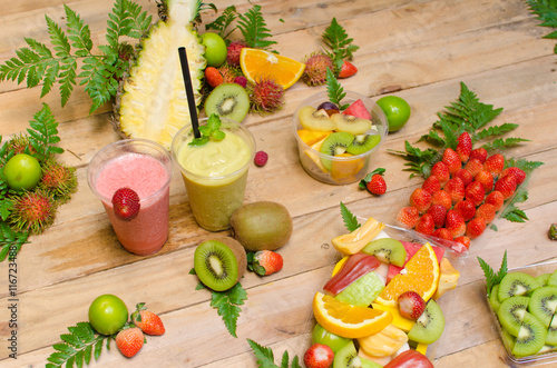 Assortment of tropical exotic fruits with smoothie and fresh jui