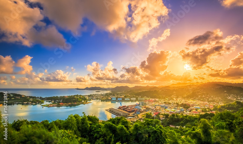 Photo Stands Caribbean First golden rays of sun over city
