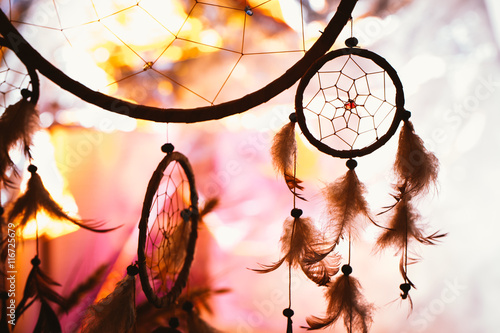 Fototapeta black and white photo of a dream catcher at sunset purple dark background obraz