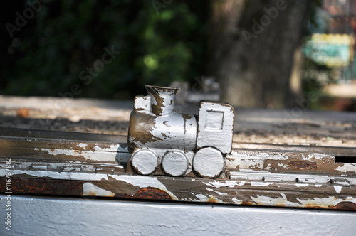 plakat wooden train in a Park