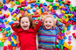 Children playing with colorful blocks.