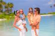 Happy beautiful family on white beach vacation