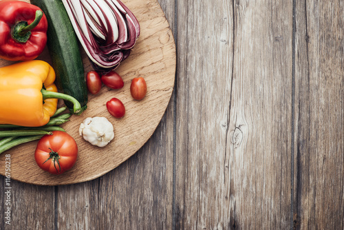 Vegetables in a rustic kitchen Canvas Print